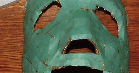 ancient jade mask using paper mache strips construction paper and gold paint