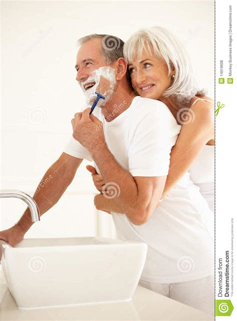 with wife in bathroom senior man shaving in bathroom with wife watching royalty