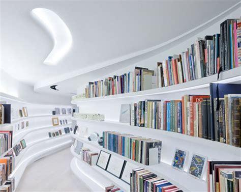 Prefab Built In Bookcases White Interior Curved Walls Wild Art Collector Condo