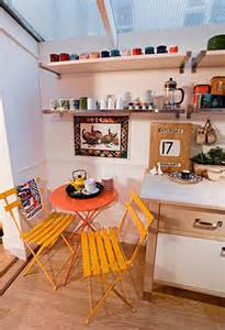 cute style kitchen: small white eclectic kitchen design with cafe style chairs