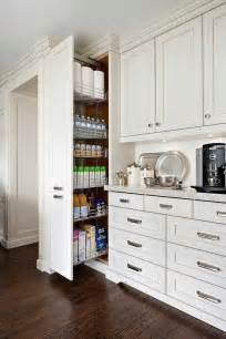 coffee station next to a floor to ceiling pull out pantry cabinet