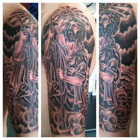 half sleeve tattoo with cross religious st