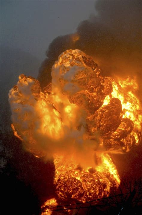 West Virginia Burning by Two Trains Derail Tank Cars Burning In West Virginia