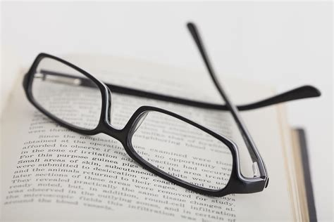 studio of reading glasses on book photograph by