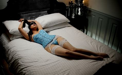 woman tied to bed bondage tied up in stockings nerovenere