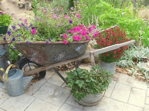 Wheelbarrow Garden Planter by Wheelbarrow Planter Gardening That I