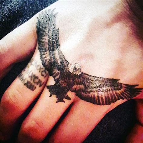 eagle tattoo in hand 75 eagle tattoos for men a soaring flight of designs