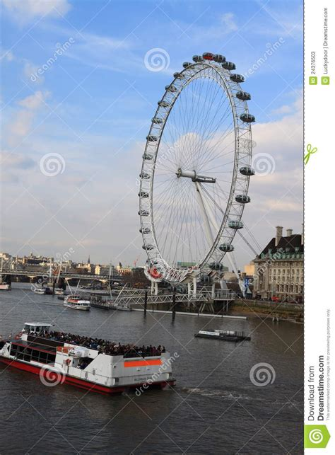 thames river boat cruise and london eye london eye and tour boat editorial stock photo image