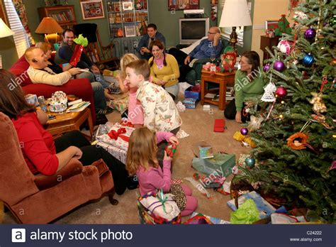 Family opening and giving presents to each other on ... Happy Kids Opening Christmas Presents