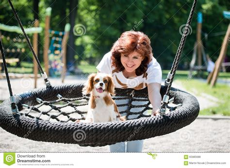 swing her woman swinging her dog stock photo image 65985688