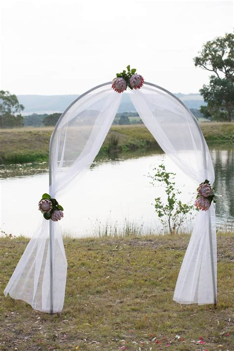 Wedding Arch Arrangement With Tulle gorgeous ceremony arch decorated with tulle and king