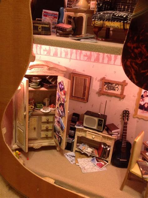 inside of a doll house a dollhouse built inside of an acoustic guitar