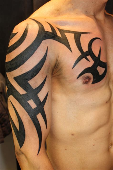 tribal chest to arm tattoo arm tribal tattoos