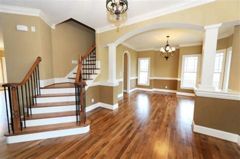 white trim with hardwood floors hardwood flooring white trim work two tone paint arch