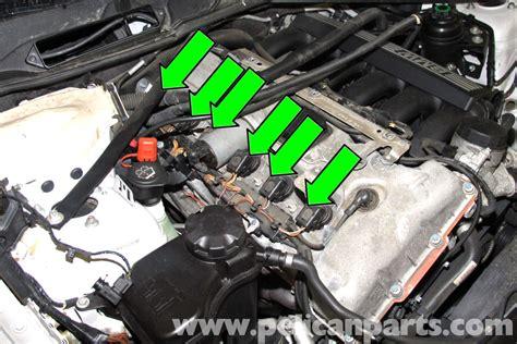 bmw  spark plug  coil replacement    pelican parts diy maintenance article