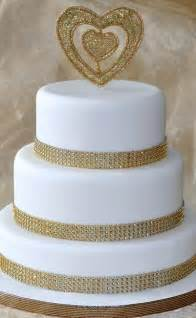 classy but simple gold and white wedding cake cake by icing to slicing cakesdecor