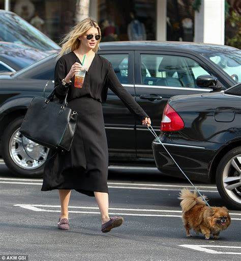 Mischa Hania Barton Shopping by Mischa Barton Opts For Comfort In Black Blouse In