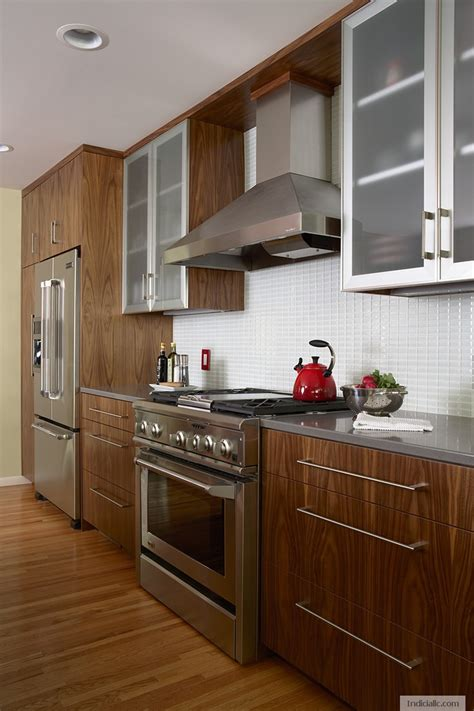 walnut cabinetry  quartz countertop ge range frosted