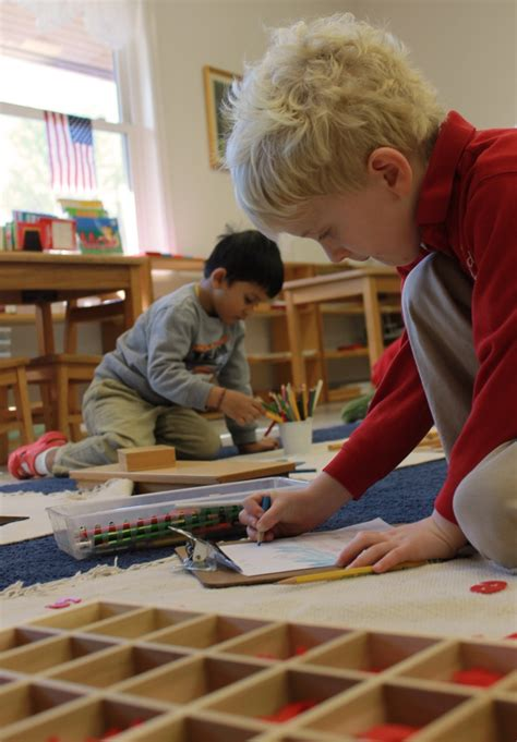 children working independently inside our montessori