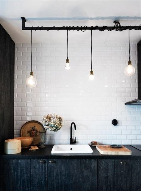 quot track quot lighting with wrapped black extension cords on a