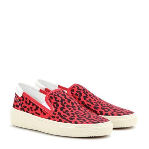 leopard print canvas sneakers lyst laurent leopard print canvas slip on sneakers