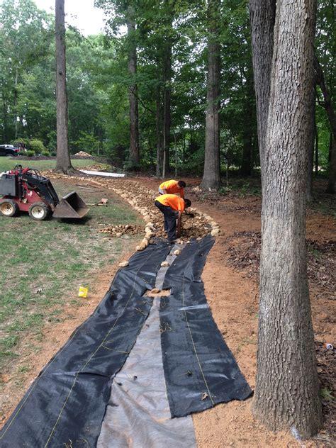 happy garden rock hill sc creek bed installation in simpsonville landscaping