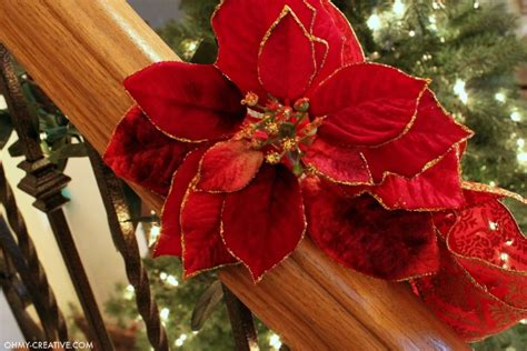 banister garland how to hang garland on staircase banisters oh my creative