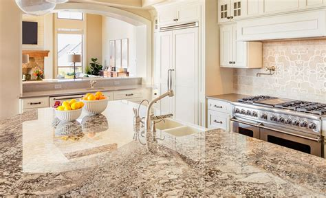 white kitchen island with granite countertop and prep sink organize kitchen cabinets and drawers cobblestone