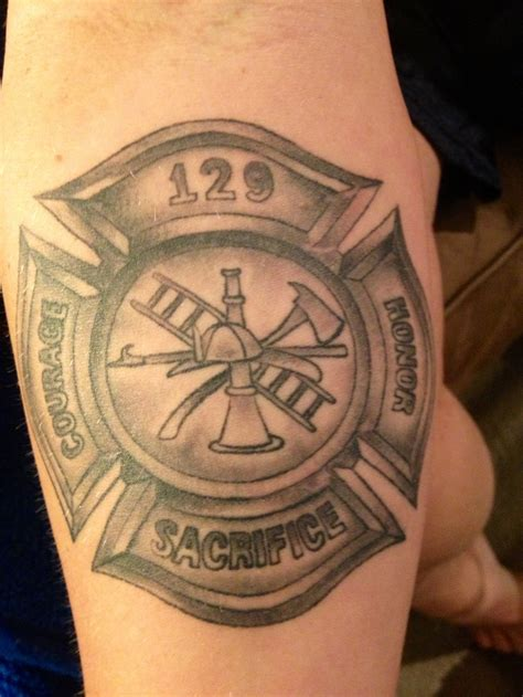 tattooed firefighter maltese cross right forearm done by twizted images
