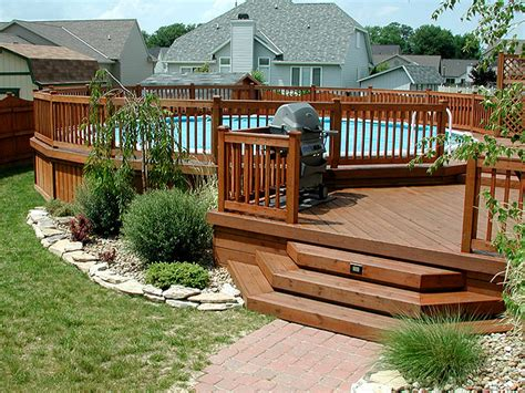 two level backyard multi level deck with above ground pool around the house