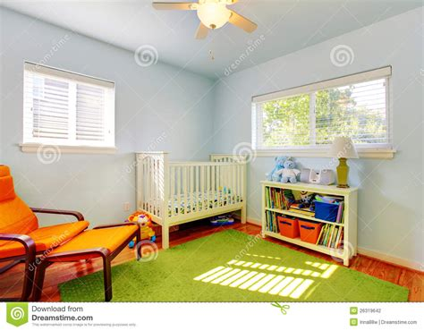 design nursery baby nursery room design with green rug blue walls and orange chair stock photography image