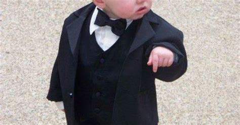 Suit Baby Meme - a little boy in a suit pointing down with a funny