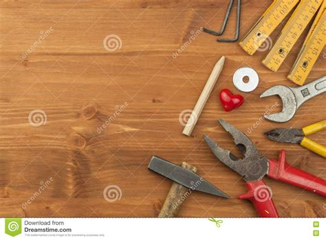 household repairs set of tools and instruments on wooden background
