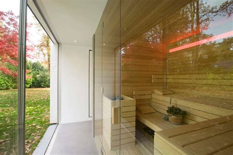 Kitchen Clocks bespoke sauna with glass fronting looking out onto garden