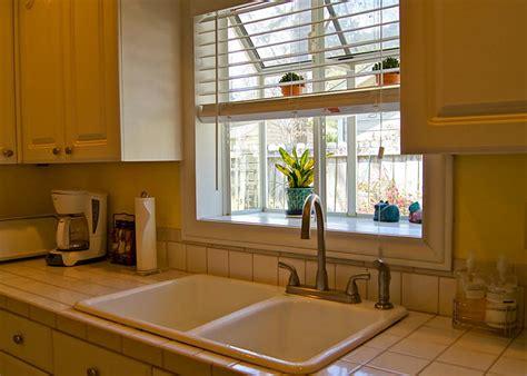 window over kitchen sink window over kitchen sink windows pella kitchen garden