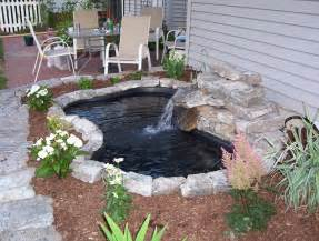 garden fountain ideas water running a few flowers planted and mulched time to relax