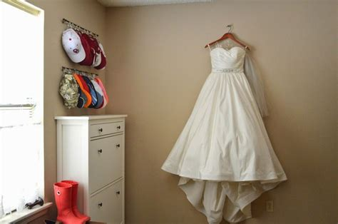 wedding dress hung in the closet pink pearls