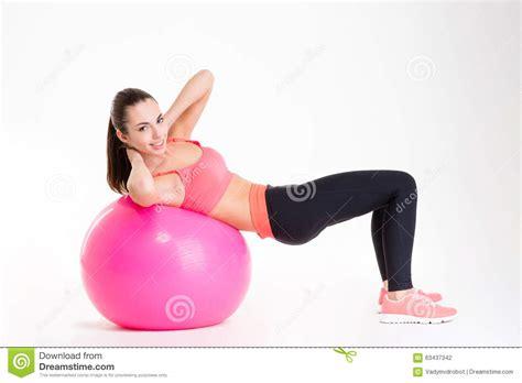cheerful beautiful fitness girl training abdominal muscles