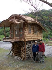 small house on stilts tiny house on stilts with a curved roof tiny house pins