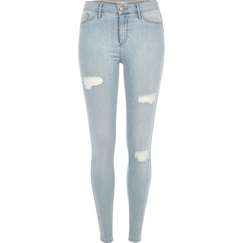 river island light wash ripped molly jeggings in blue lyst
