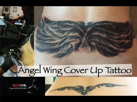 angel kiss tattoo tracy kiss angel wings coverup tattoo by john capasao