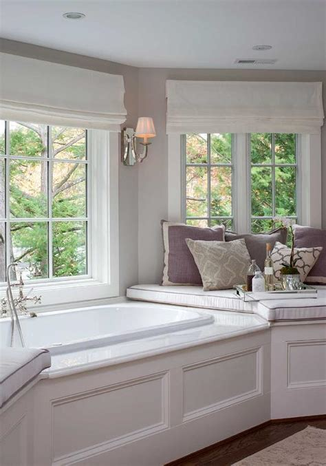 corner bay window bay window wainscoted tub transitional bathroom