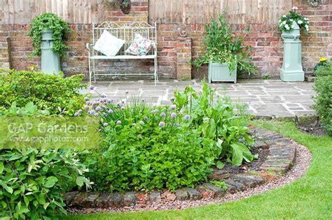 gap gardens cottage garden with circular segmented herb