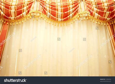 red and yellow curtains luxurious red and yellow curtains as a background stock