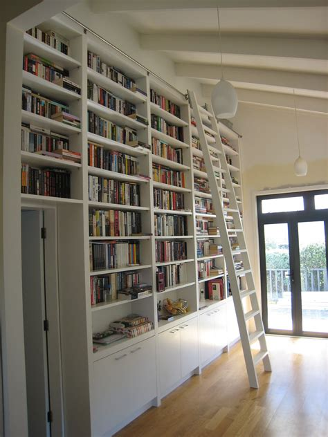 wall library modern small home library with l shaped white glaze wooden
