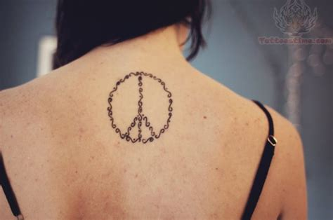 peaceful tattoos peace on upperback