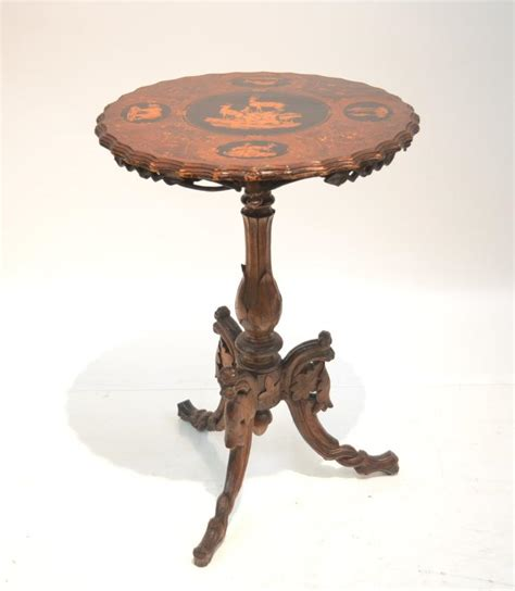 carved black forest side table with deer