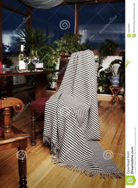 draped over throw draped over an antique chair stock photo image
