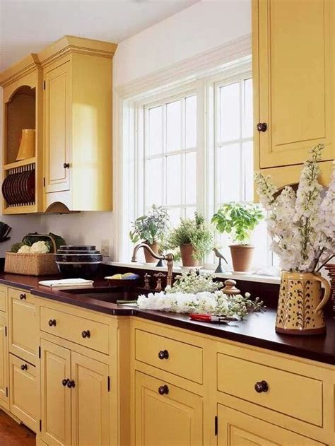 yellow painted kitchen cabinets yellow kitchen kitchens pinterest