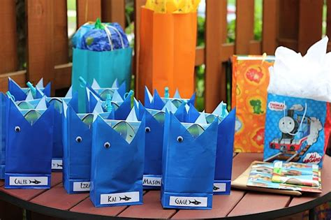 baby shark themed party shark party favor bags birthday party ideas pinterest